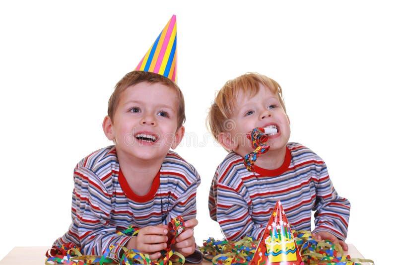 Party time. Two boys celebrate birthday isolated on white royalty free stock photos
