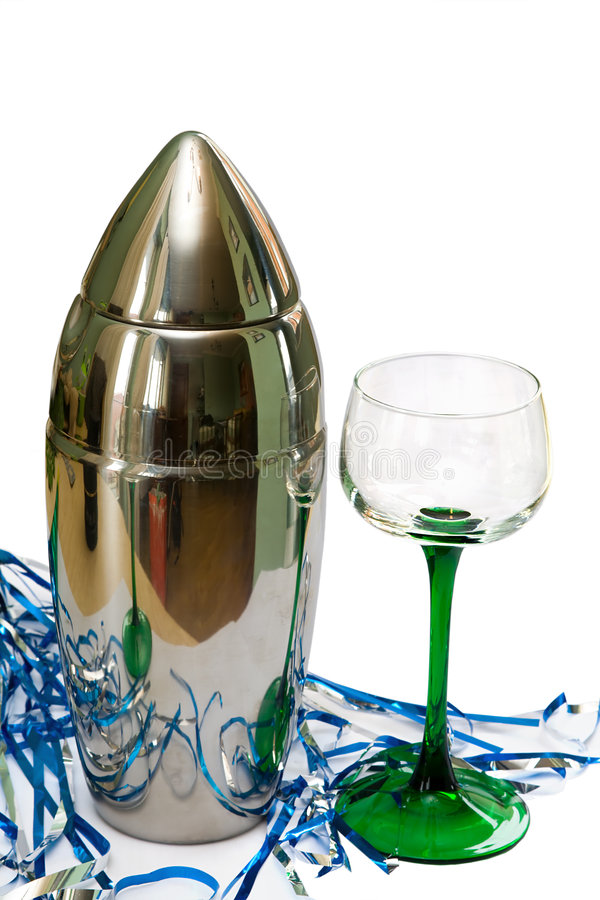 Party Time. Silver coctail shaker and glass with party streamers. Isolated on white stock photo
