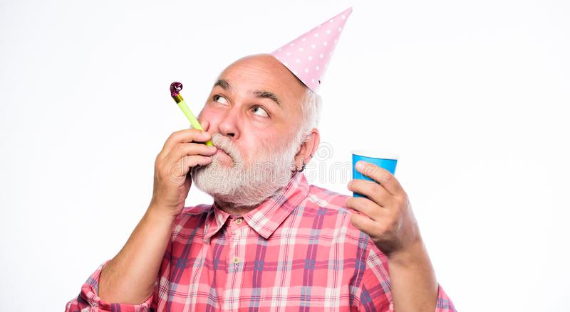 Party time. happy birthday. corporate party. man hold party cone hat and whistle. happy man with beard. retirement party. Anniversary holiday celebration stock images