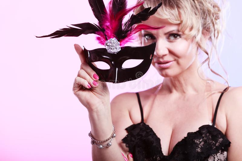 Woman middle aged holds carnival mask royalty free stock photos