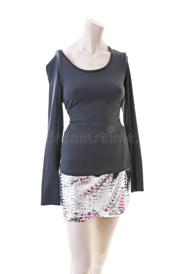Party top black and silver with mini mirror skirt on mannequin full body shop display. Woman fashion styles, clothes on royalty free stock image