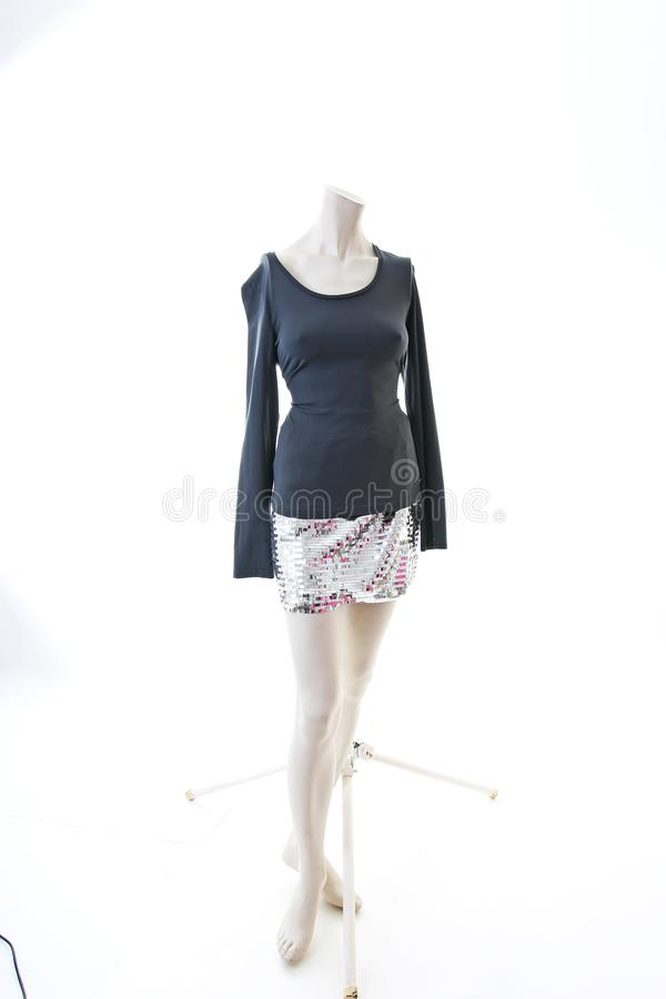 Party top black and silver with mini mirror skirt on mannequin full body shop display. Woman fashion styles, clothes on stock images