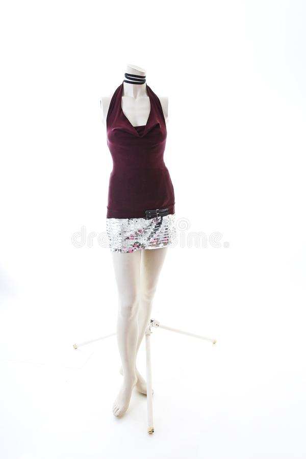 Party top black and silver with mini mirror skirt on mannequin full body shop display. Woman fashion styles, clothes on stock image