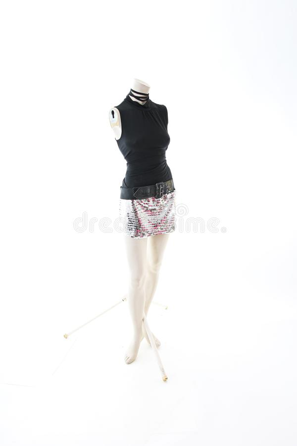Party top black and silver with mini mirror skirt on mannequin full body shop display. Woman fashion styles, clothes on white stud stock images