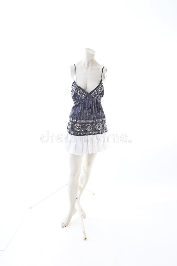 Party top black and silver with mini mirror skirt on mannequin full body shop display. Woman fashion styles, clothes on white stud stock image