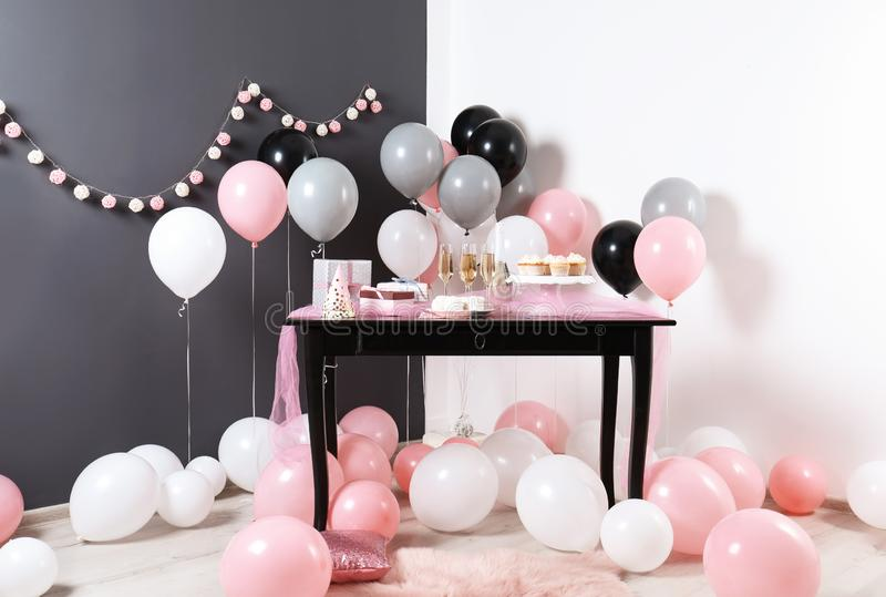 Party treats and items on table in room stock images