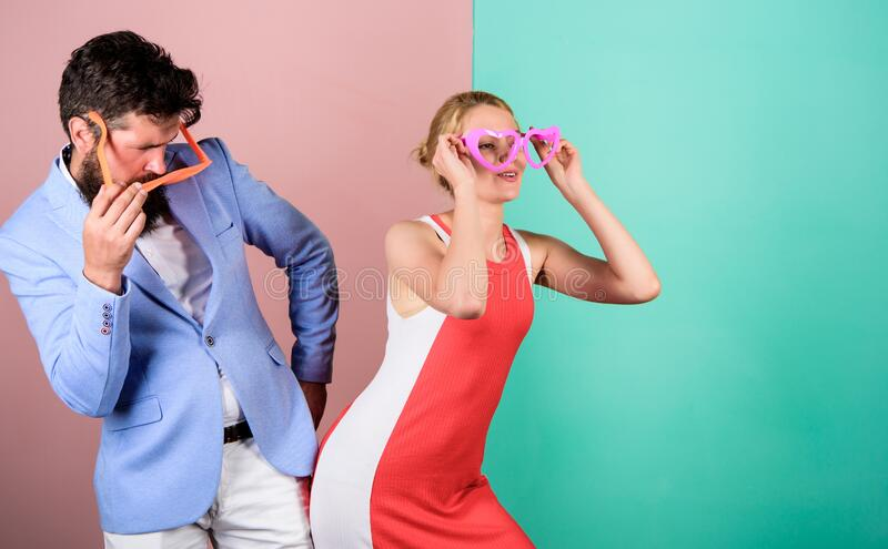 Party vibes. party fun. couple in love. bearded man with pretty woman. hipster guy and girl party glasses. Office party royalty free stock photo