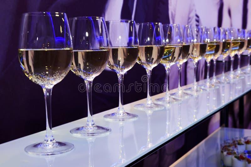 Party white wine glasses stock photo