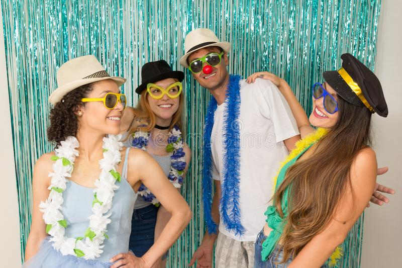 Partygoers are celebrating Carnival in Brazil. Friends are dancing Carnival songs.. Multi ethnic group of Brazilian friends. Costumed revelers are happy and royalty free stock photos