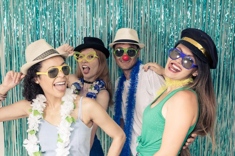 Partygoers are celebrating Carnival in Brazil. Friends make face. Multi ethnic group of Brazilian friends. Costumed revelers are happy and celebrating the stock image
