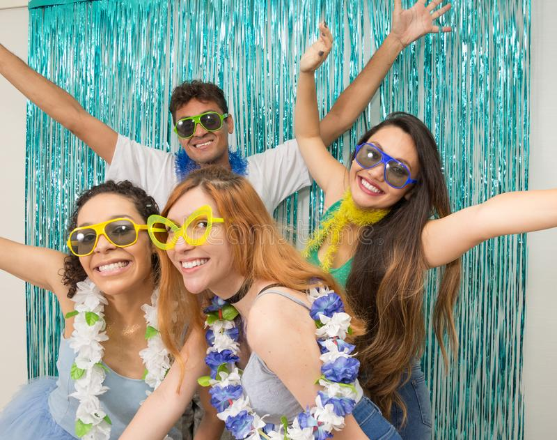 Partygoers are celebrating Carnival in Brazil. With open arms for the revelry.. Multi ethnic group of Brazilian friends. Costumed revelers are happy and royalty free stock photo
