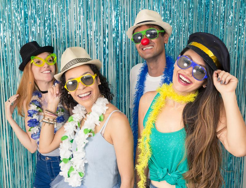 Partygoers are celebrating Carnival in Brazil. People are happy. Multi ethnic group of Brazilian friends. Costumed revelers are happy and celebrating the stock photos