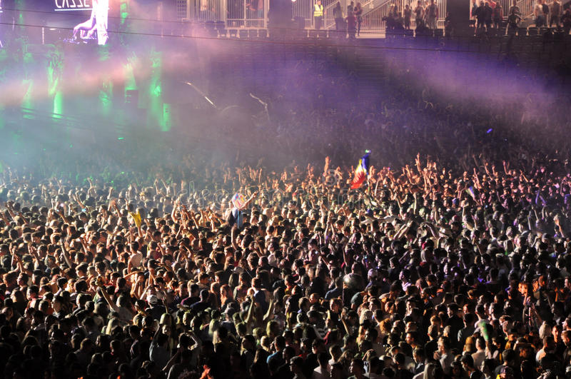 Partying crowd at a live concert. CLUJ NAPOCA, ROMANIA – JULY 31, 2015: Crowd of partying people dancing during a Casette live concert at the Untold stock photos