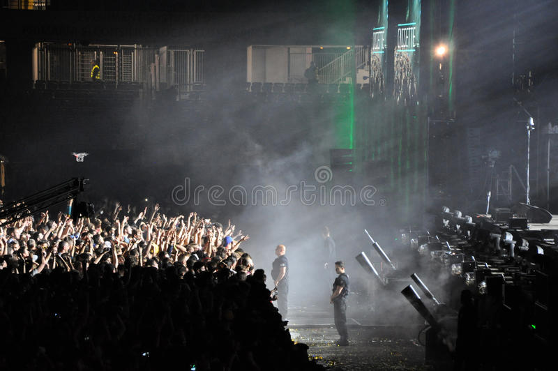 Partying crowd at a live concert. CLUJ NAPOCA, ROMANIA – JULY 31, 2015: Crowd of partying people dancing during a Casette live concert at the Untold royalty free stock photo