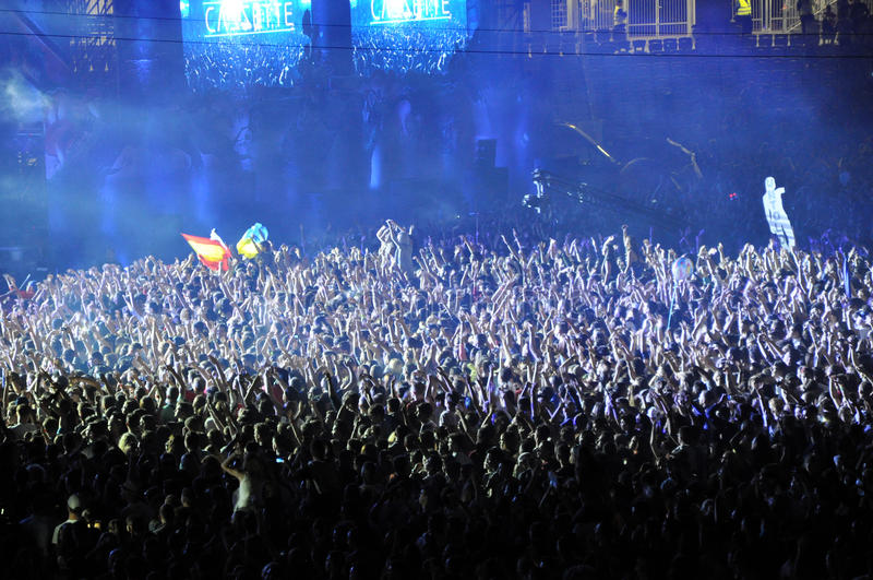 Partying crowd at a live concert. CLUJ NAPOCA, ROMANIA – JULY 31, 2015: Crowd of partying people dancing during a Casette live concert at the Untold stock photography