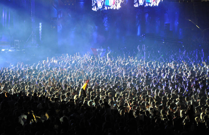 Partying crowd at a live concert. CLUJ NAPOCA, ROMANIA – JULY 31, 2015: Crowd of partying people dancing during a Casette live concert at the Untold royalty free stock photos