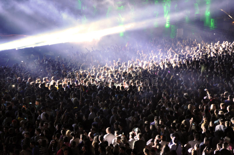 Partying crowd at a live concert. CLUJ NAPOCA, ROMANIA – JULY 31, 2015: Crowd of partying people dancing during a Casette live concert at the Untold royalty free stock images