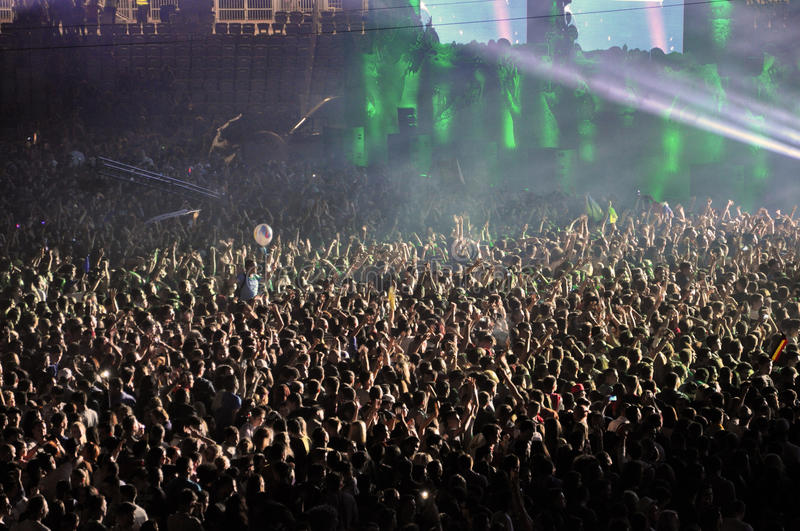Partying crowd at a live concert. CLUJ NAPOCA, ROMANIA – JULY 31, 2015: Crowd of partying people dancing during a Casette live concert at the Untold stock image