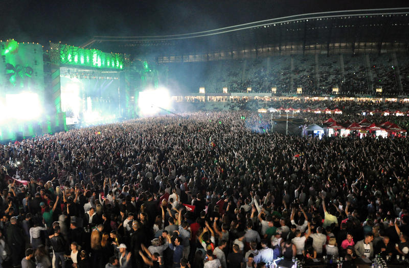 Partying crowd at a live concert. CLUJ NAPOCA, ROMANIA – JULY 31, 2015: Crowd of partying people dancing during a Casette live concert at the Untold stock images