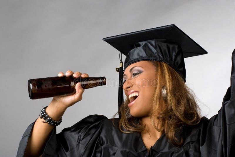 Partying feliz do graduado imagem de stock royalty free