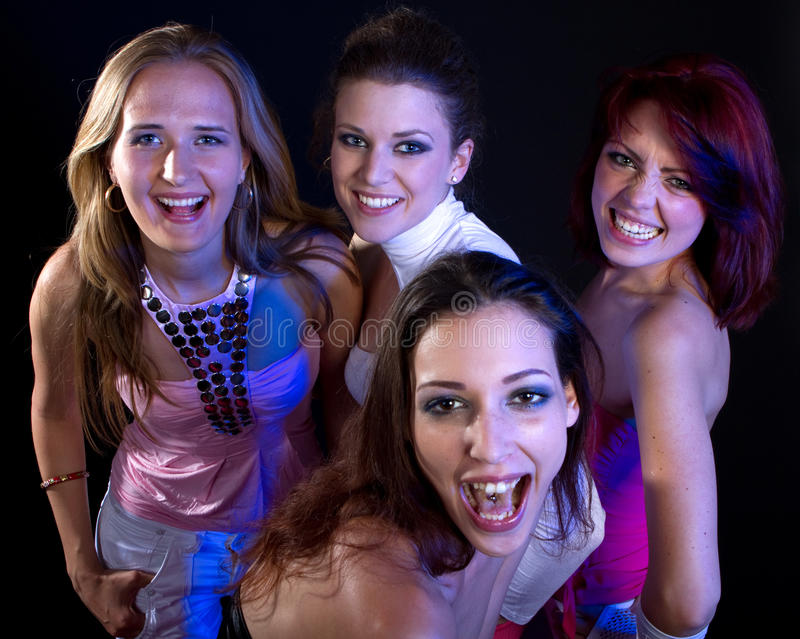 Partying women. A group of four young fresh women partying. Nice lively image stock photo