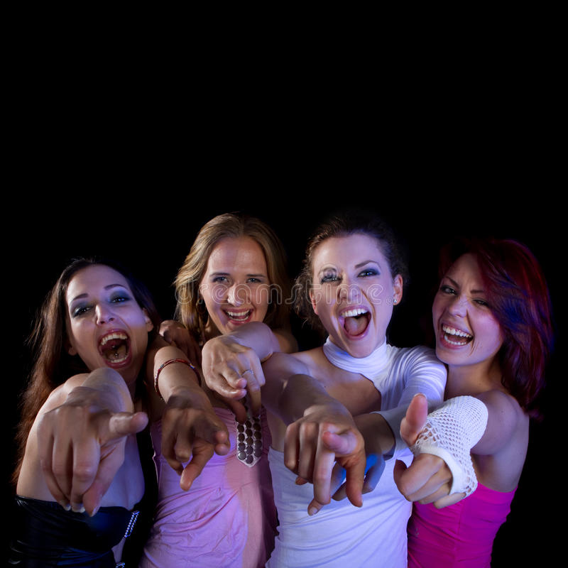 Partying women. A group of four young fresh women partying. Nice lively image royalty free stock photos