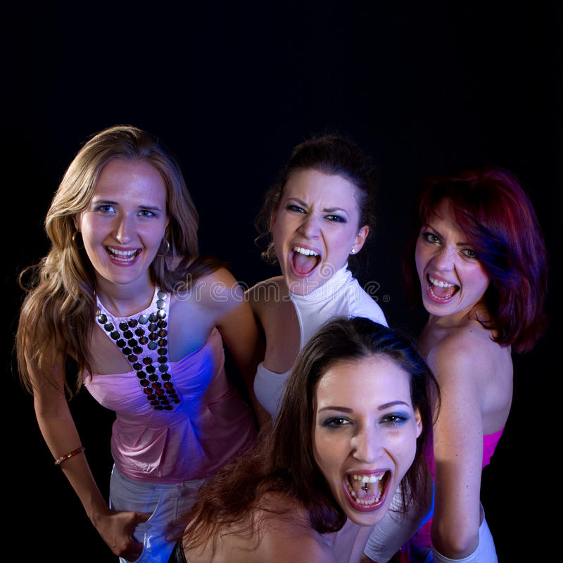 Partying women. A group of four young fresh women partying. Nice lively image royalty free stock photo