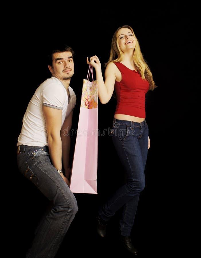 pary śmieszni zakupy potomstwa zdjęcie royalty free