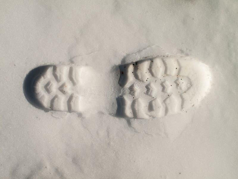 Pas de botte sur la neige images stock