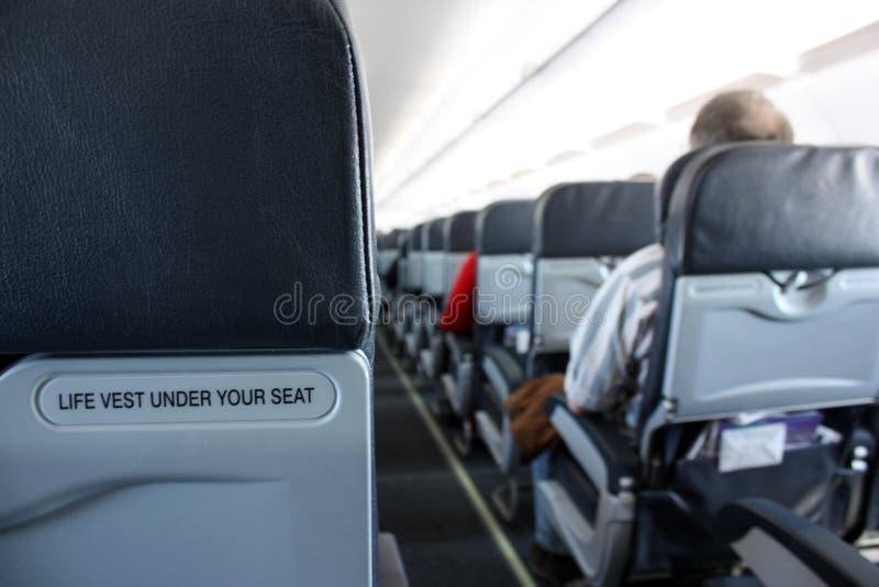 Pasajero en un aeroplano foto de archivo
