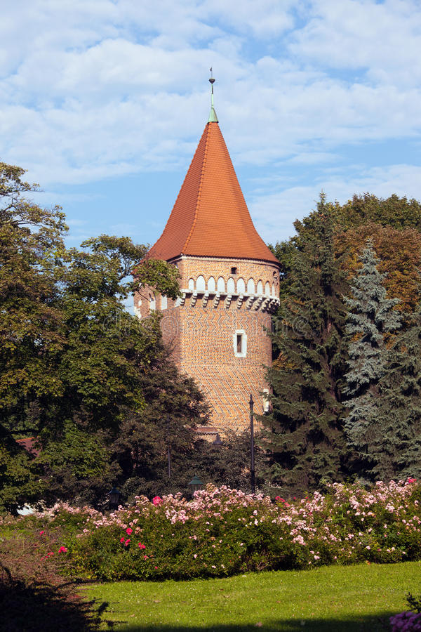 Pasamonikow Tower and Planty Park in Krakow. Baszta Pasamonikow Gothic Tower and Planty Park in Krakow, Poland, part of the old city wall fortification stock photos