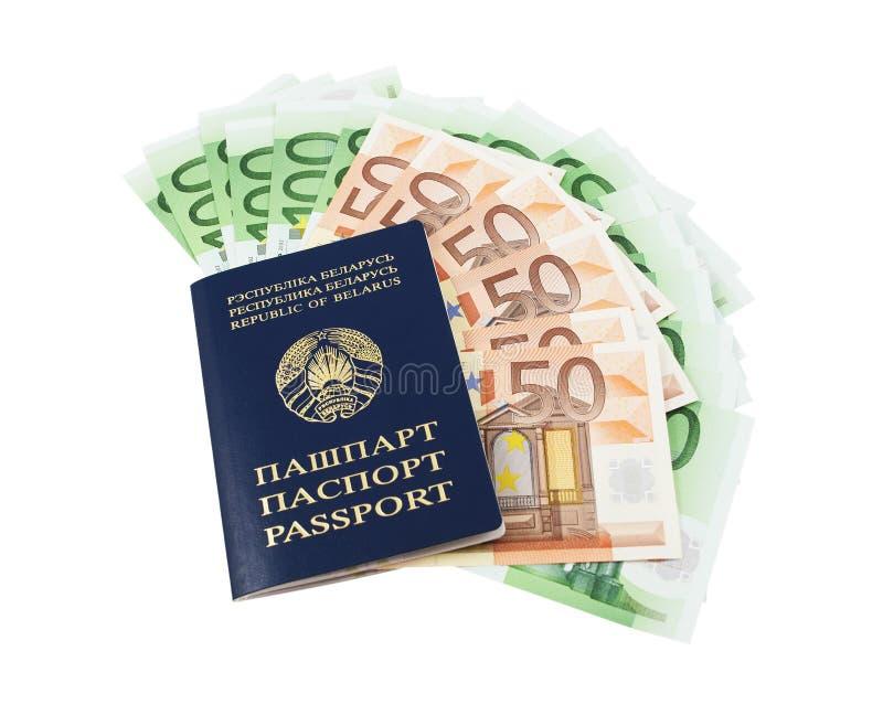 Pasaporte bielorruso con euros fotografía de archivo libre de regalías