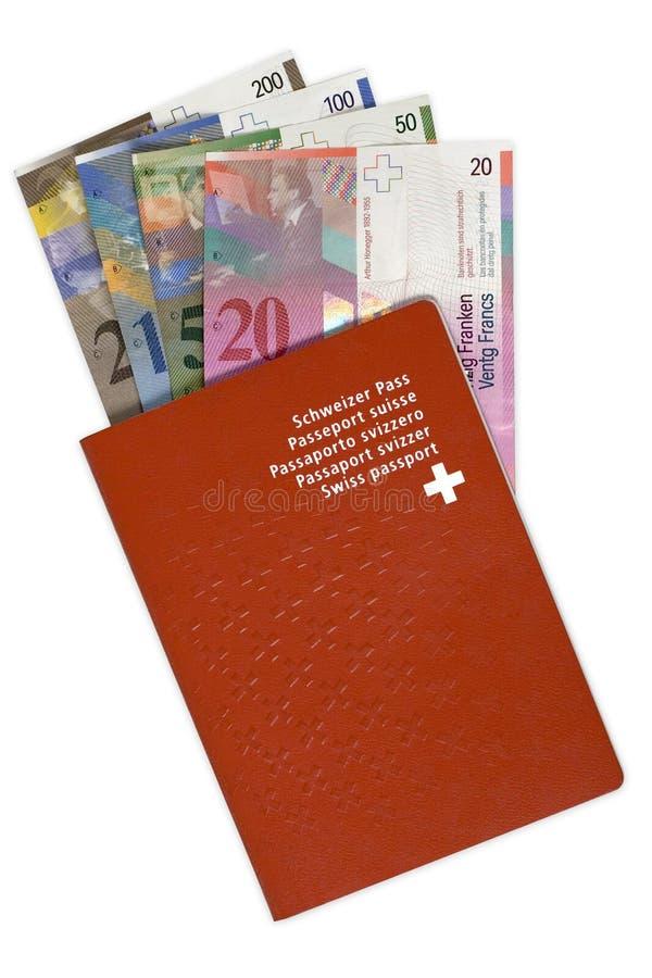 Pasaporte y dinero suizos fotos de archivo