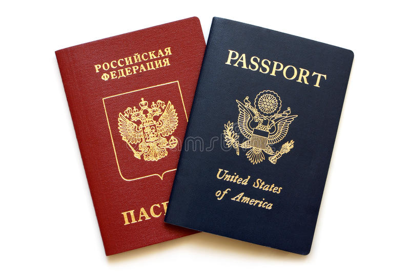 Pasaportes rusos y americanos imagen de archivo