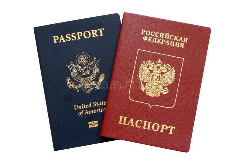 Pasaportes rusos y americanos foto de archivo