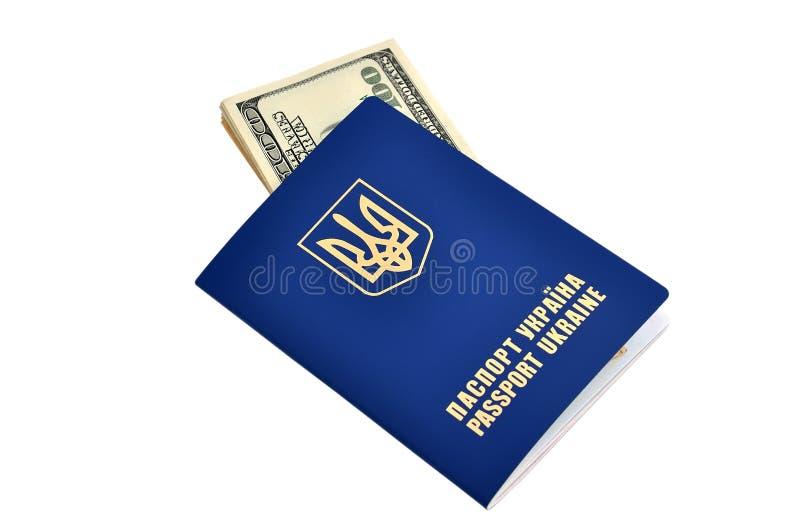 Pasaportes y dólares fotos de archivo