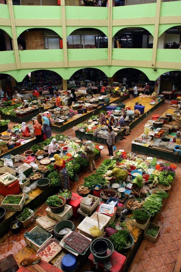 Pasar Siti Khadijah (Kota Bharu Central Market), Kelantan, Malaysia. Stock image of Muslim woman selling fresh vegetables at market in Kota Bharu, Malaysia stock photos
