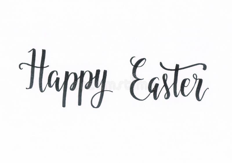 Pascua feliz - inscripción de las letras de la mano negra libre illustration