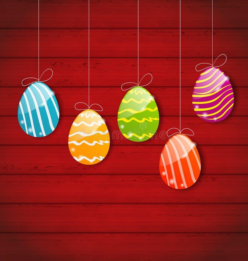 Pascua tres huevos coloridos ornamentales en fondo de madera ilustración del vector