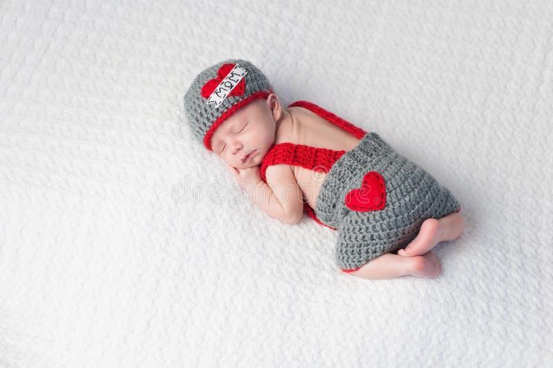 Pasgeboren Babyjongen die a dragen royalty-vrije stock afbeeldingen