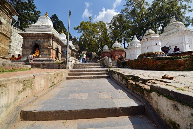 Pashupatinath Hindu temples. Nepal. PASHUPATINATH - OCTOBER 8: Unidentified locals visiting the holy Pashupatinath Hindu temples during the Dashain Hindu stock photo