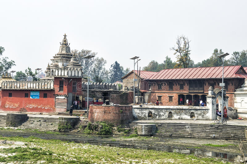 Pashupatinath, Kathmandu, Nepal. Pashupatinath serves as the seat of the national deity, Lord Pashupatinath. It is also the place of cremation ceremony along the stock images