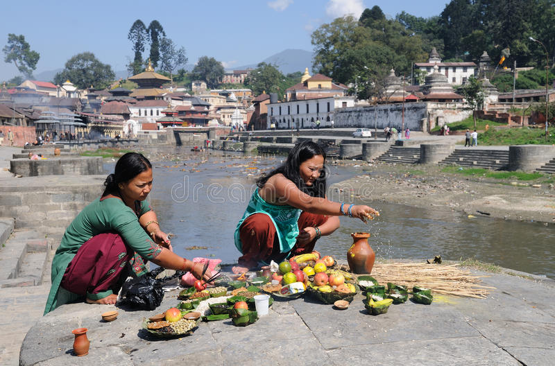 Pashupatinath Ritual. Puja at the Hindu pelgrimage and cremation site near Kathmandu, Nepal. Useful in all publications about Asia stock photography