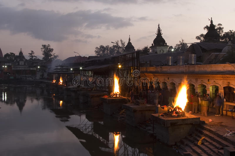 Pashupatinath temple complex on Bagmati River in the evening. Funeral pyres. Kathmandu Valley, Nepal royalty free stock images