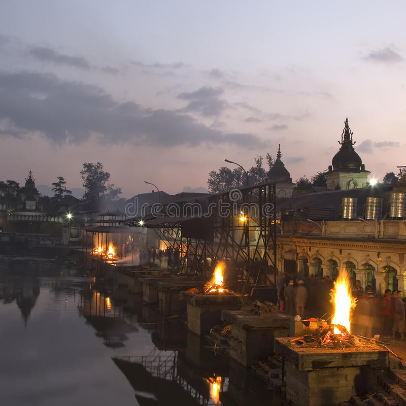 Pashupatinath temple complex on Bagmati River in the evening. Funeral pyres. Kathmandu Valley, Nepal royalty free stock photo