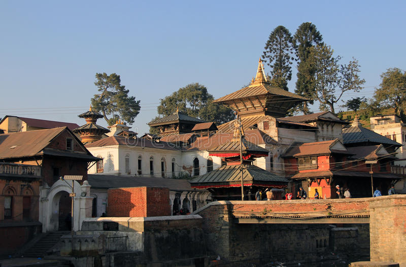 Pashupatinath. The Pashupatinath Temple is a famous, sacred Hindu temple dedicated to Pashupatinath and is located on the banks of the Bagmati River This temple royalty free stock photo