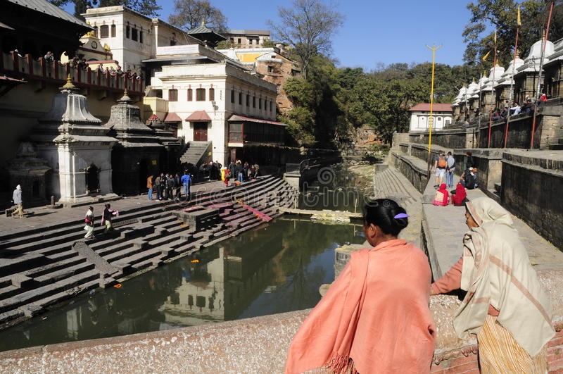 Pashupatinath temple Kathmandu. Pashupatinath temple in Kathmandu is a holy site on the Bagmati river where Hindu people are cremated after they die. The ashes royalty free stock photos