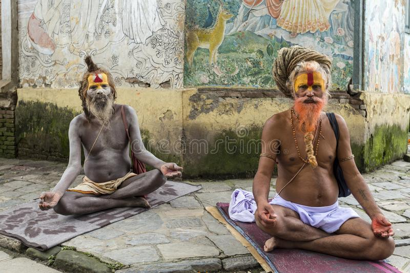 Pashupatinath Temple, Nepal. Two Sadhus meditating in the Pashupatinath Temple, the most famous and sacred Hindu temple complex, a UNESCO World Heritage Site royalty free stock image