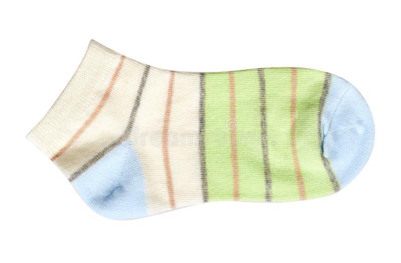 Pasiasta bawełniana skarpeta, dziecka obuwie Odosobniony t?o fotografia stock