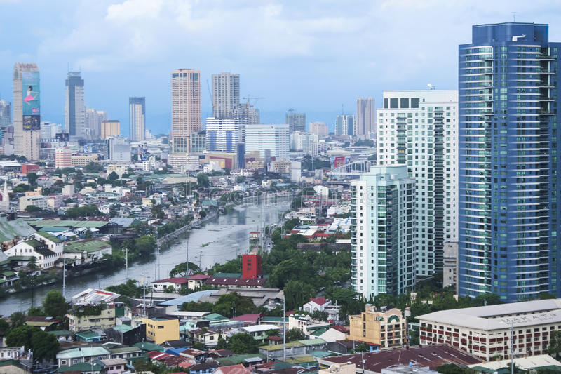 Pasig river makati manila city skyline philippines. MANILA - JULY 6:Old sugar refinery on the pasig river in makati surrounded by high rise condo buildings on stock images